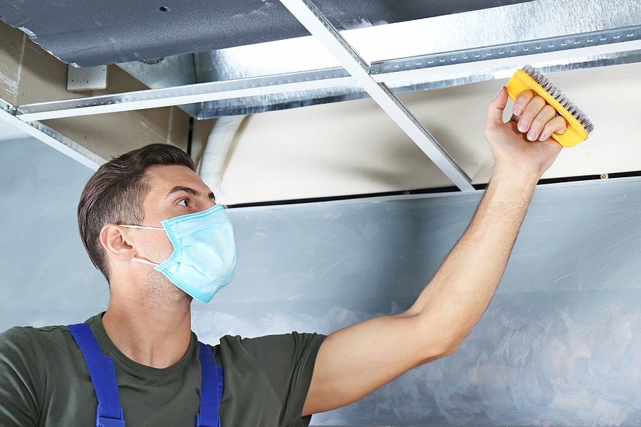 man cleaning the air duct